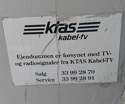 Old sign from the former regional telephone company, KTAS, indicating that the building is connected with TV- and radio signals from KTAS