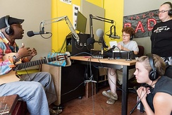 A musician interviewed in a radio studio