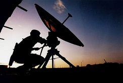 Soldier adjusting a Small SATCOM ground terminal to Skynet in 2000