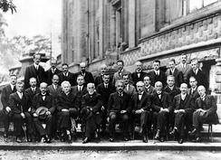 Solvay Conference of 1927, with prominent physicists such as Albert Einstein, Werner Heisenberg, Max Planck, Hendrik Lorentz, Niels Bohr, Marie Curie, Erwin Schrödinger and Paul Dirac