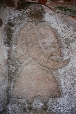 A priest of Svantevit depicted on a stone from Arkona, now in the church of Altenkirchen.