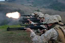 U.S. Marines fire their shotguns
