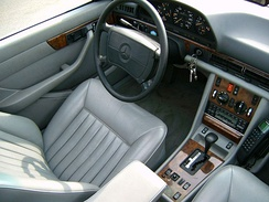 Late model W126 with Airbag, leather seats, and Burlwood interior wood trim. Left hand Drive.