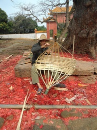 Basket making in Hainan, China. The material is bamboo strips.