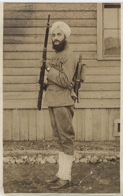 Sergeant Bhagat Singh Thind in U.S. Army uniform during World War I at Camp Lewis, Washington, in 1918. Thind, an American Sikh, was the first U.S. serviceman to be allowed for religious reasons to wear a turban as part of their military uniform.
