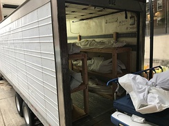 "Deceased in a 16 m (53 ft) ""mobile morgue"" outside a hospital in Hackensack, New Jersey"