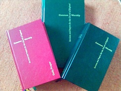 Three Common Worship liturgy books. From left to right they are Daily Prayer (red), Pastoral Services (green) and the Main Volume (black).