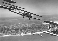 Curtiss B-2 Condor formation flight over Atlantic City, N.J. S/N 28-399 is in the foreground (tail section only). Aircraft were assigned to 11th Bombardment Squadron, 7th Bombardment Group at Rockwell Field, California. This flight of 4 aircraft completed cross-country flight to Atlantic City, NJ.