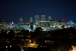 Downtown Beverly Hills at night with Century City in the distance