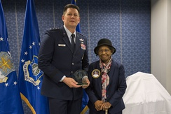 Air Force Space Commander presents Dr. Gladys West with an award as she is inducted into the Air Force Space and Missile Pioneers Hall of Fame for her GPS work on Dec. 6, 2018.