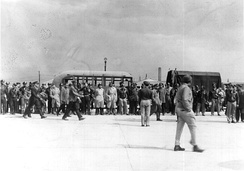 Officers of the 477th Bombardment Group at Freeman Field, Indiana, about to board air transports to take them to Godman Field, Kentucky.[a 2]