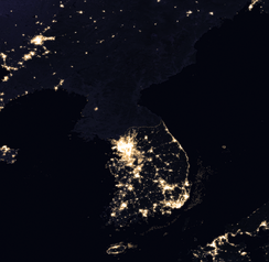 Satellite image of the Korean peninsula taken at night showing the extent of the division between the Koreas today; note the difference in light emitted between the two countries