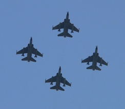 A formation of four Mirage F1CRs flying over Avenue des Champs-Élysées, Paris, 2006