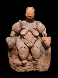 Statuette of a nude, corpulent, seated woman flanked by two felines from Çatalhöyük, dating to c. 6000 BCE, thought by most archaeologists to represent a goddess of some kind[73][74]