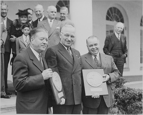 Robert M. La Follette, Jr. (left) and Jesse P. Wolcott (right) receiving the Collier's Congressional Award from President Harry S. Truman (April 17, 1947)