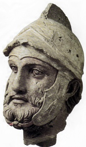 A sculpted head (broken off from a larger statue) of a Parthian soldier wearing a Hellenistic-style helmet, from the Parthian royal residence and necropolis of Nisa, 2nd century BC