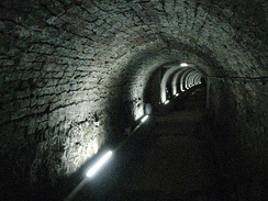 Victoria Tunnel, built 1842. In 1935 after a government document requested its cities build air-raid shelters, part of the tunnel was converted.[33]