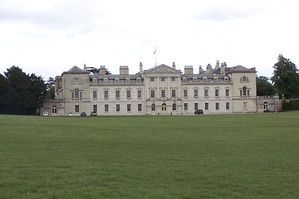 English Palladianism. Woburn Abbey, designed by Burlington's student Henry Flitcroft in 1746. Palladio's central temple is no longer free standing, the wings are now elevated to near equal importance, and the cattle sheds terminating Palladio's design are now clearly part of the façade.