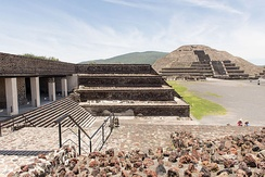 View of the Pyramid of the Moon and entrance to the Quetzalpapálotl Palace. During its peak in the Classic era, Teotihuacán dominated the Valley of Mexico and exerted political and cultural influence in other areas, such as in the Petén Basin.