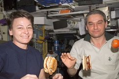 Astronauts making and eating hamburgers on board the ISS, August 2007.
