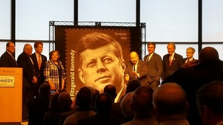 The dedication of a new forever stamp to honor what would be President John F. Kennedy's 100th birthday.