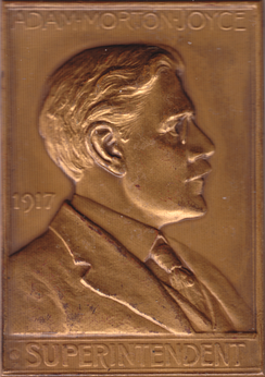 Philadelphia Mint Superintendent Adam M. Joyce decried the Lincoln cent and other new coinage, believing that they struck badly.  Plaquette by George T. Morgan.
