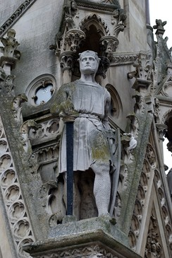 A statue of Simon de Montfort on the Haymarket Memorial Clock Tower in Leicester, England