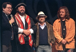 From left: journalist Vincenzo Mollica, Pavarotti, Lucio Dalla and Zucchero on the first edition of Pavarotti & Friends (1992)