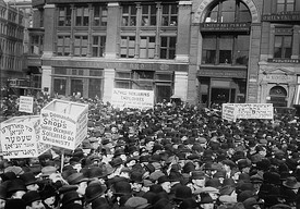 May Day 1913, strikers and protesters rally in Union Square, with signs in Yiddish, Italian and English