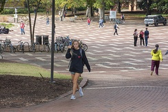 Students walk through the brickyard between classes at North Carolina State University.