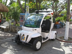 A GEM e2 used by the Tourist Police in Playa del Carmen, Mexico, being recharged