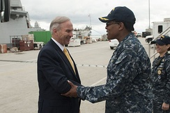Navy commander greets House Armed Services' Seapower and Projection Forces Subcommittee Chairman Forbes in 2016