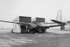 "Douglas A/RB-26C-40-DT Invader serial 44-35599 of the 117th TRW in a temporary wooden nose ""hangar"", January 1953. Notice the temporary Pierced Steel Planking used for the parking apron with the snow and ice. This aircraft was sold to France in September 1956. It was eventually withdrawn from use in May 1967 and scrapped."