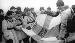 Red Army soldiers display a captured Finnish banner, March 1940
