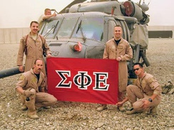 U.S. Army soldiers, presumably members of Sigma Phi Epsilon, display that fraternity's flag in Iraq in 2009.