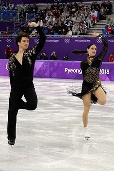 Performing twizzles during the short dance at the 2018 Winter Olympics