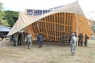 Setup of a solar shade canopy for humanitarian aid and disaster relief. The solar shade has the potential to provide enough energy for continuous 24-hour use.