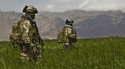 U.S. Army Special Forces soldiers from the 3rd Special Forces Group patrol a field in the Gulistan district of Farah, Afghanistan