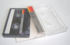 A blank compact cassette tape and case