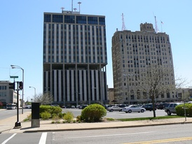 The now-demolished Genesee Towers (left), and Mott Foundation Building (right). The Flint Journal's former headquarters (now used by the Michigan State University College of Human Medicine) is to the far left.