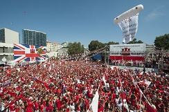 Thousands of Gibraltarians dress in their national colours of red and white during the 2013 Gibraltar National Day celebrations.