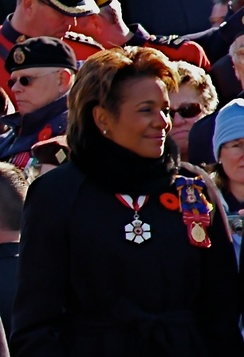 Michaëlle Jean wearing the insignia of the Order of Canada and Order of Military Merit along with the Canadian Forces Decoration
