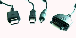 Mobile phone charger plugs prior to the universal standard (left to right) Samsung E900, Motorola V3, Nokia 6101 and Sony Ericsson K750