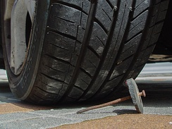 "Improvised tire puncturing device (slang term ""Ninja"") – iron nail inserted into a rubber disc (from used tire)"