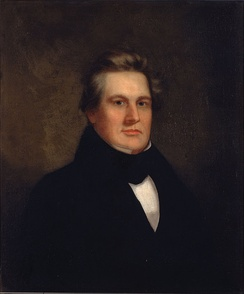 Portrait of Millard Fillmore dressed largely in black facing the artist