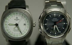 "Different kinds of movements move the hands differently as shown in this 2 second exposure. The left watch has a 24-hour analog dial with a mechanical 1/6 s movement, the right one has a more common 12-hour dial and a ""1 s"" quartz movement"