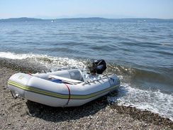 A PVC inflatable boat on a beach