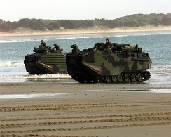 Two USMC AAVS emerge from the surf at Freshwater Bay, Australia.