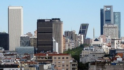 AZCA business district in Madrid on the left, with one of the Puerta de Europa towers in the centre and with the CTBA skyscrapers at the back-right of the picture.