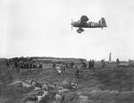A Westland Lysander of No. 13 Squadron provides aiming practice for members of the Home Guard at the Western Command Weapons Training School at Altcar, Lancashire in September 1940.